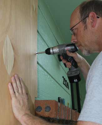 Installing Plywood Window Storm Shutters